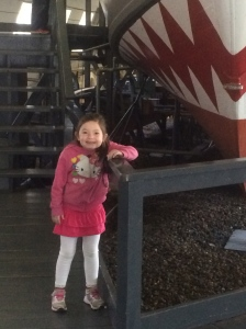 """She was so excited to take a picture with the """" Shark Boat"""""""